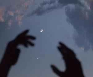 clouds, hands, and moon image