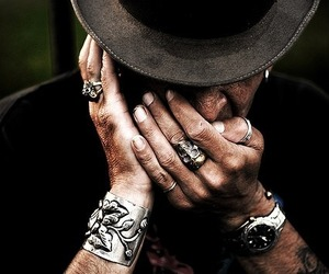 hat and tattoo image