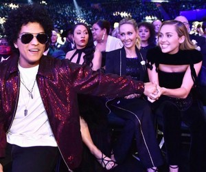 miley cyrus, bruno mars, and grammys image