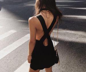 black dress and crossed back image