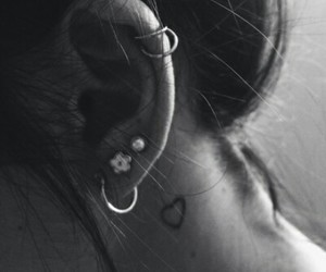 piercing, tattoo, and earrings image
