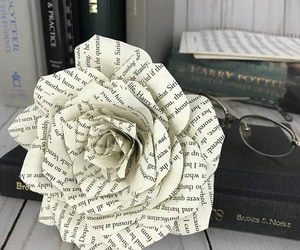 harry potter book, paper rose, and anniversary gift image