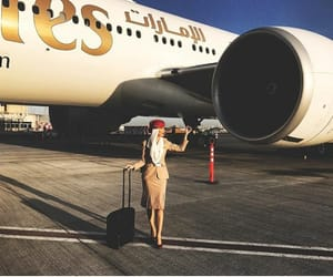 emirates, flight attendant, and girl image