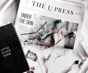 white, newspaper, and black image