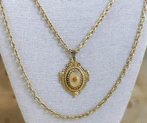 chain necklace, gold tone, and multi strand image