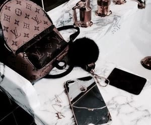 black, brown, and Louis Vuitton image