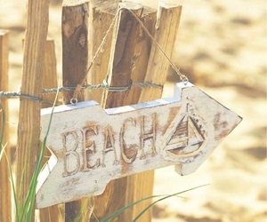 arena, beach, and sign image