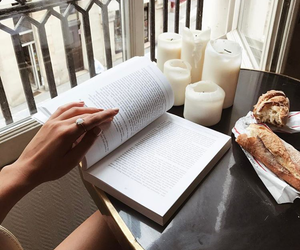 book, candle, and food image