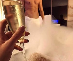 bubble bath, champagne, and lovers image