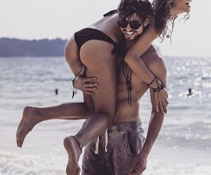beach couple laughs love image