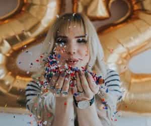 girl, 22, and balloons image