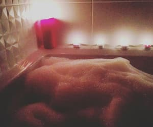 bath, candles, and decor image