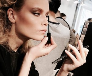 model, Natasha Poly, and backstage image