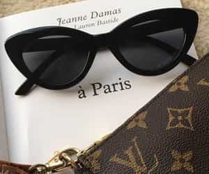 book, Louis Vuitton, and cat eye sunglasses image