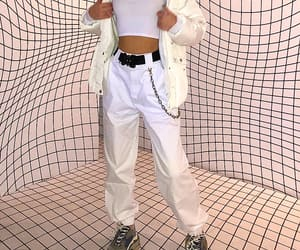 white pants, black belts, and white crop tops image
