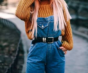 black belts, blue denim overalls, and long straight pink hair image