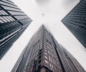buildings, plane, and city image