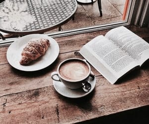 book, coffee, and croissant image