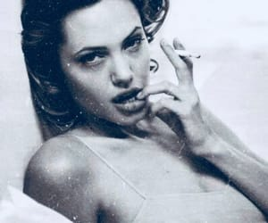 Angelina Jolie, black and white, and cigarette image