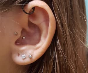 ear, tragus, and earrings image