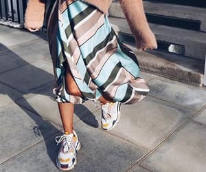 pullover, sneakers, and satin skirt image