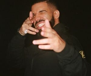 Drake, champagne, and money image