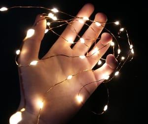dark, hand, and light image