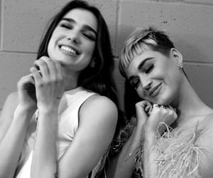 dua lipa, katy perry, and singer image