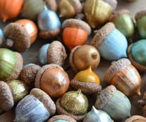 acorns, painted, and ornaments. image