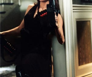 Angelina Jolie, guns, and Mr & Mrs Smith image