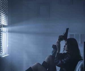 girl and gun image