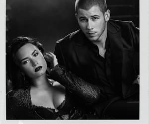 demi lovato, nick jonas, and billboard image