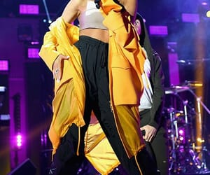 ariana grande, yellow, and side to side image