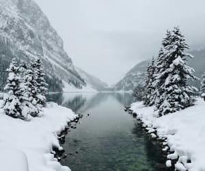 lake, mountains, and snow image