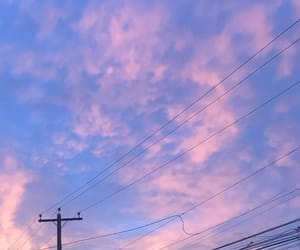 wires, clouds, and sky image