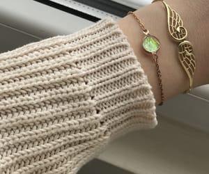 bracelet, golden, and Nude image