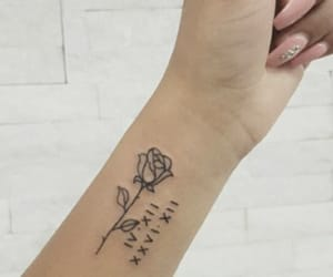 flower, ink, and roman numerals image