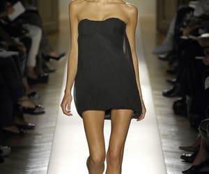 model, Natasha Poly, and black image