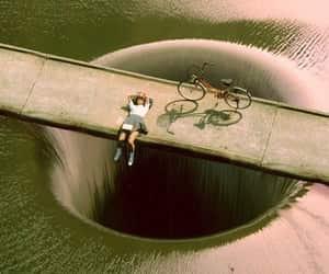 bike, water, and hole image