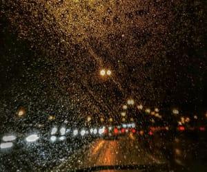 city, night, and rain image