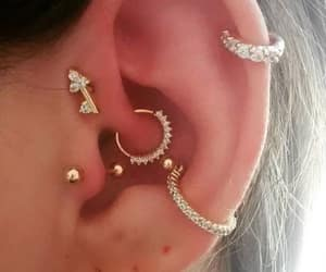 conch, ear, and earrings image