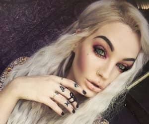 black nails, green eyes, and hairstyle image