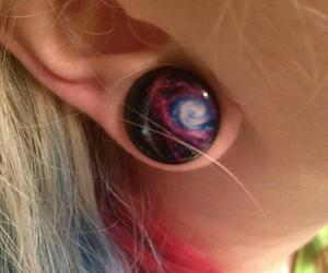 ear, galaxy, and plug image