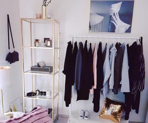bedroom, clothes rack, and interior image