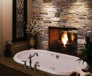 bathroom, fireplace, and bath image