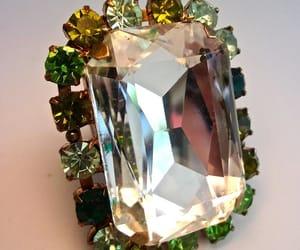 brass, green, and rhinestones image