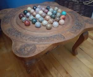 marbles, pebbles, and table image