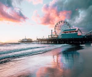 clouds, sea, and ferris wheel image