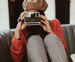 beret, camera, and red sweater image