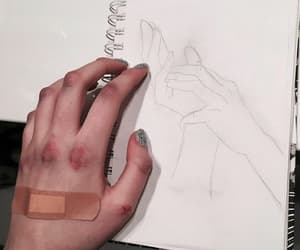 book, hand, and draw image